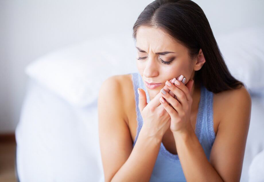 Woman With Tooth Pain Needing A Root Canal